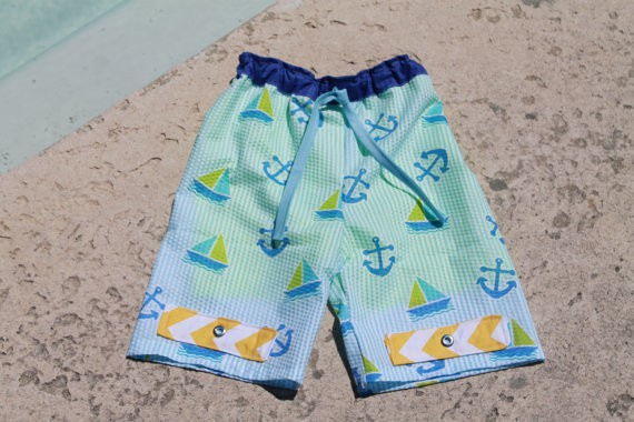 Boy's swim trunks sewing pattern from Seamingly Smitten with tabbed detail.