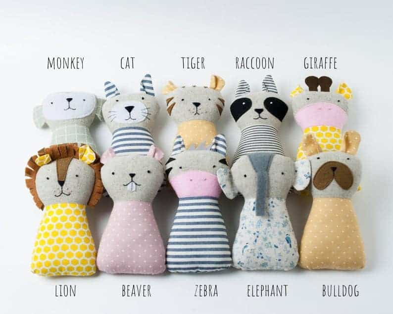 Simple baby toy sewing pattern with a monkey, cat, raccoon, giraffe, lion, beaver, zebra, elephant and bulldog.