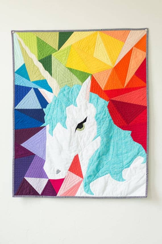 Maybe the Unicorn Paper Piecing Quilt Pattern with geometric rainbow background.