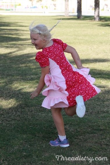 It's lots of fun to twirl in the With Love dress. Sewing pattern by Ellie and Mac.