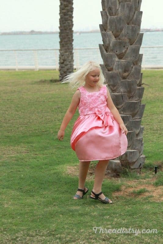 Look how the Poinsettia Party Dress twirls (sewing pattern by GYCT Designs)
