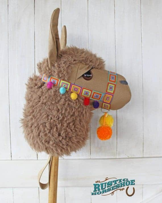 """Who doesn't love a stick animal? This Llama """"hobby horse"""" sewing pattern from Rustic Horse Shoe is a fun and different toy to sew for kids."""