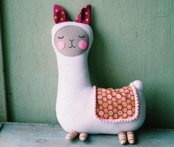 This llama plush pattern from Nata Patterns has lots of character. The pompom trim on the blanket is such a cute touch!