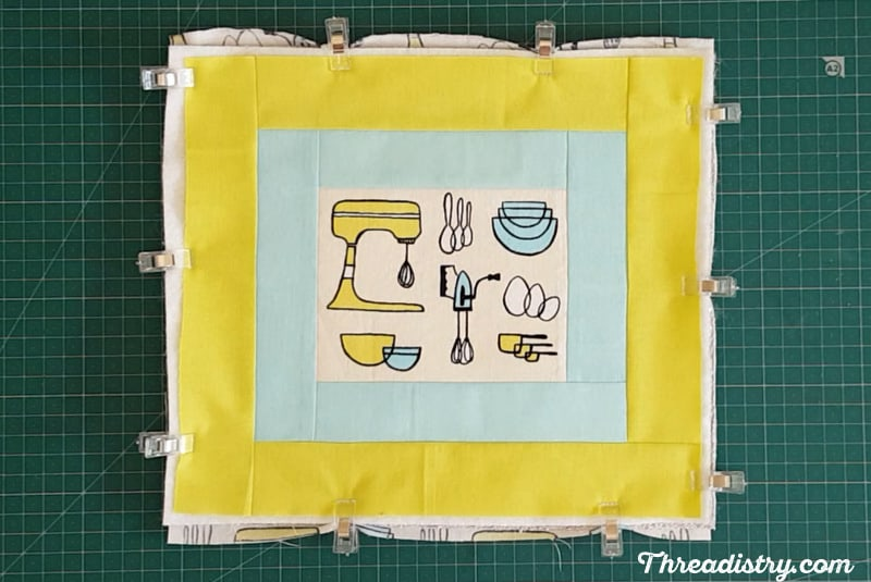 Clipping all the layers of a potholder together with Wonderclips