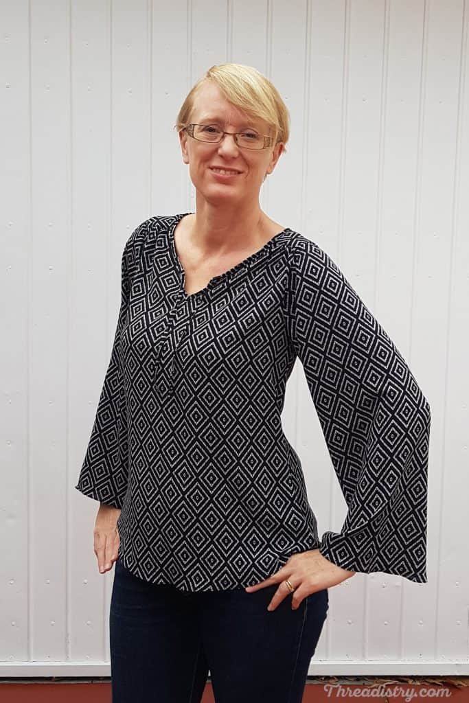 Rhapsody Blouse sewing pattern from Love Notions made in a black and white geometric ghost crepe fabric.