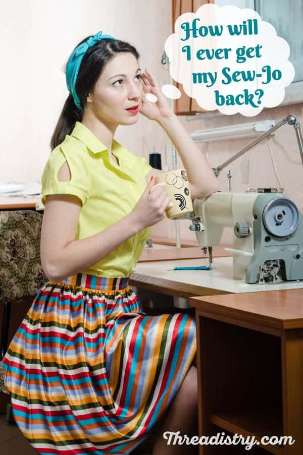 Woman sitting at vintage sewing machine, wondering how to get her sew-jo back.