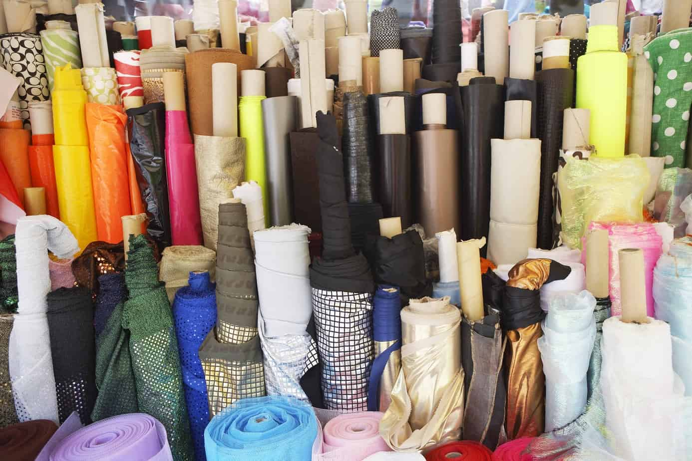 Lots of colourful bolts of fabric