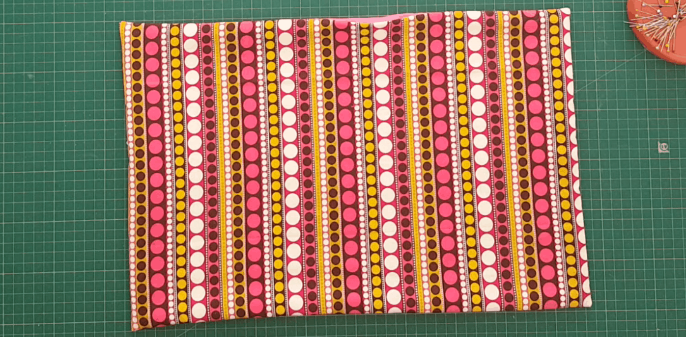 Brightly coloured fabric sewn into a placemat