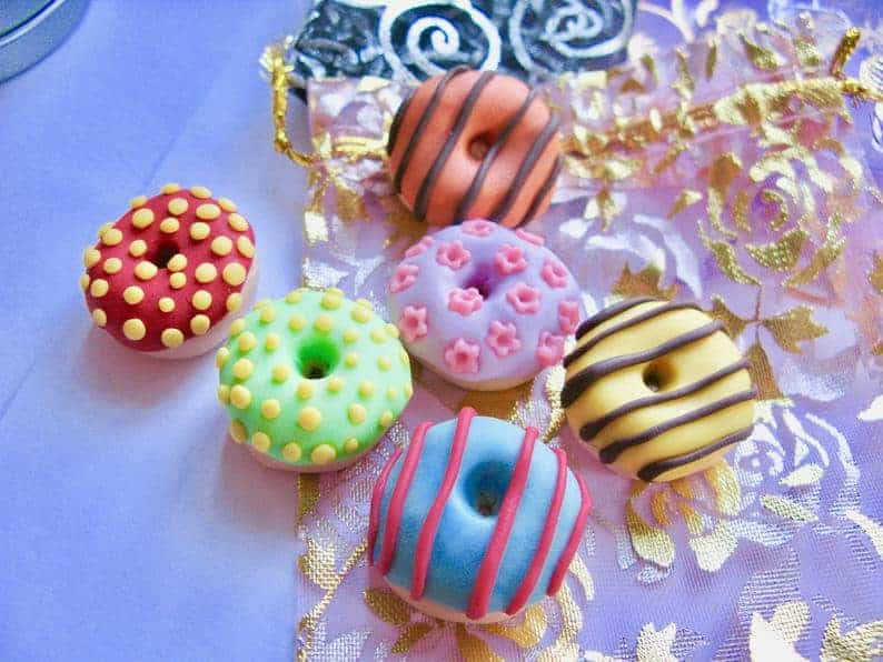 Colourful Dinky doughnut pattern weights made from polymer clay from ArtnCraftyStudio