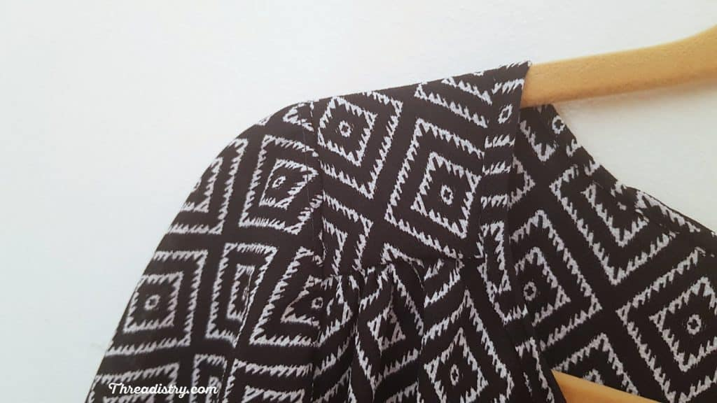 Close up photo of the Rhapsody Blouse gathering detail at the shoulder