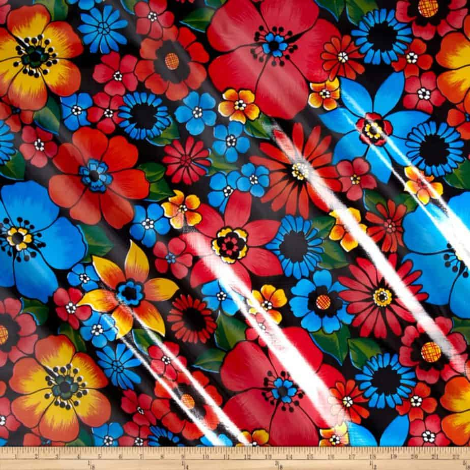 Red and blue flower print oilcloth fabric