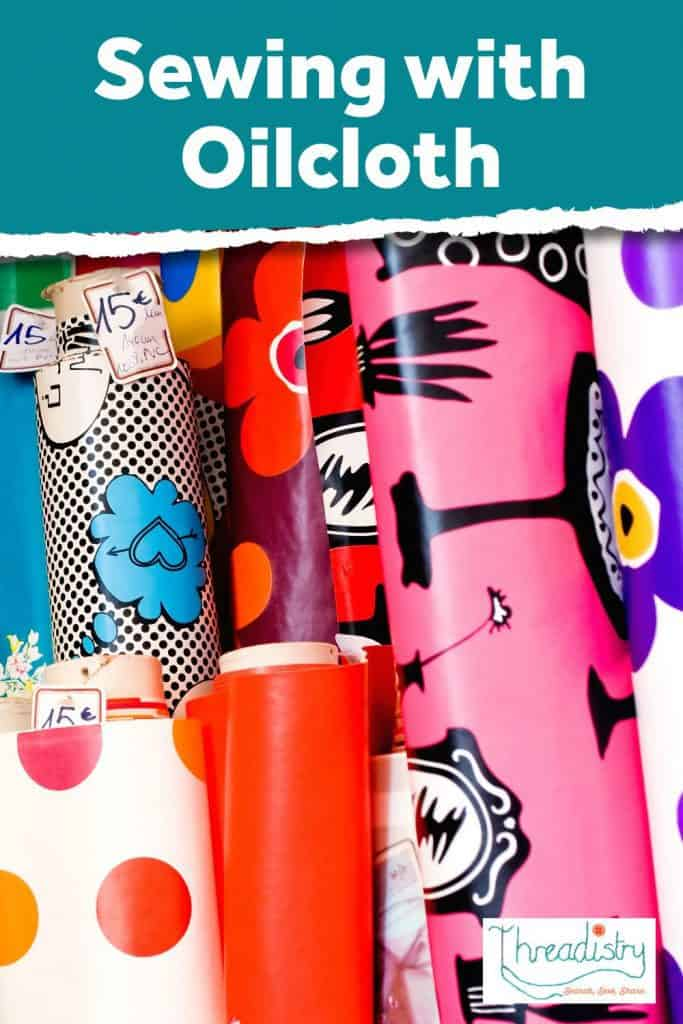 """Rolls/bolts of oilcloth fabric with text overlay """"sewing with oilcloth"""""""